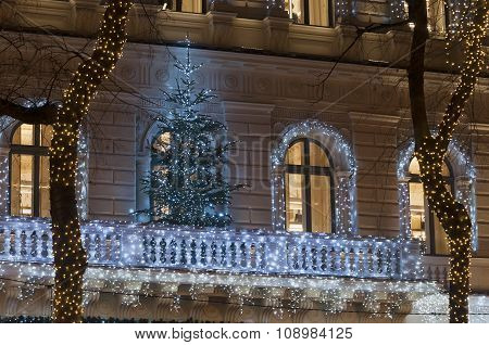 Building Facade With Light Decoration At Night With Christmas Tree