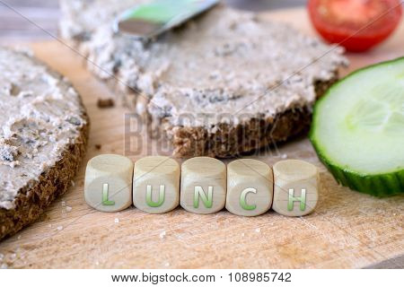 Two Slices Of Wholemeal Bread With Spread And Cucumber
