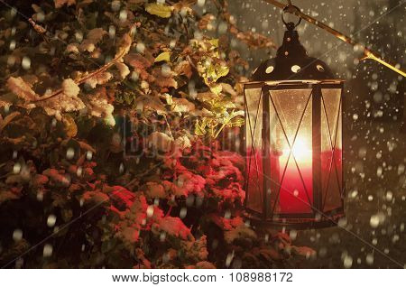 Lantern With Lighting Candle In Snowfall