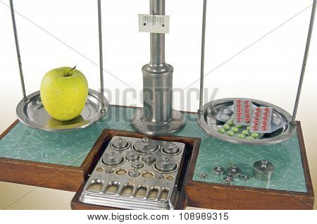 Old Style Pharmacy Scale Balanced By Apple And Drugs