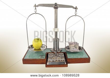 Old Style Pharmacy Scale With Money Heavier Than Yellow Apple