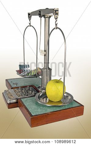 Old Style Pharmacy Scale With Yellow Apple Heavier Than Drugs