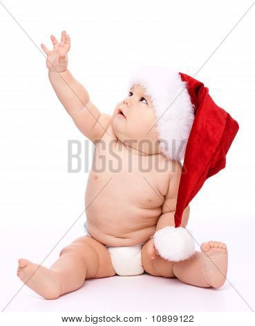 Little Child Wearing Red Christmas Cap