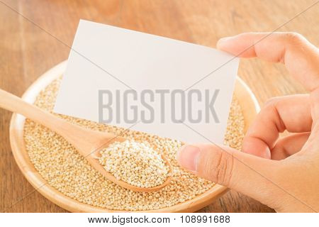 Organic Quinoa Grain And Hand On Business Card