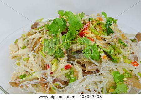 glass noodle pork spicy salad on dish