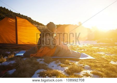 Girl Sitting In A Sleeping Bag.