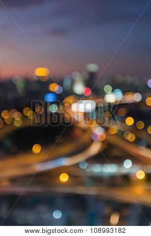 Blurred bokeh lights city interchanged at night