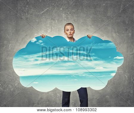 Young pretty businesswoman showing cloud concept banner