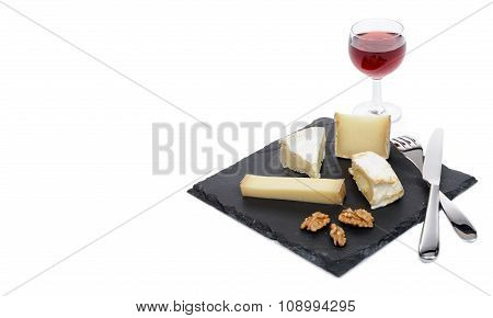 French Cheese Platter With A Glass Of Red Wine