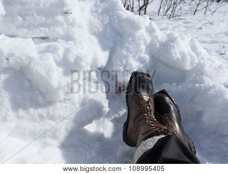 A pair of warm boots in the snow.