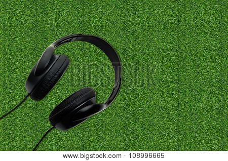 Black Earphones On The Grass