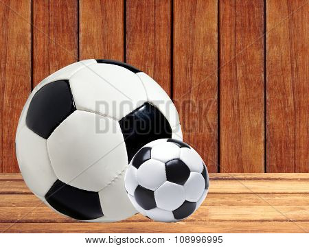 Soccer (football) Balls On Wooden Table