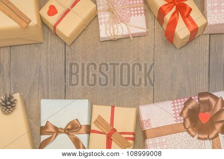 Christmas Card With Presents, Fir Tree And Pine Cones On Wooden