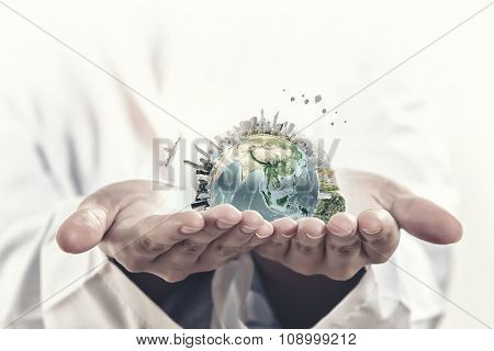 Male hands holding world concept in palms. Elements of this image are furnished by NASA