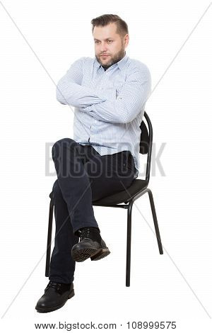 man sitting on chair. Isolated white background. arms crossed, mistrust