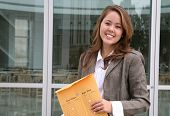 stock photo of interoffice  - a business woman delivering an envelope of office mail - JPG