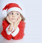 foto of gullible  - Portrait of little girl in Santa - JPG