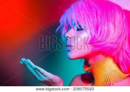 poster of High Fashion model woman portrait in colorful bright lights, beautiful party girl with trendy make-u
