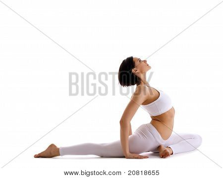 Yong woman sit in yoga asana - pigeon pose