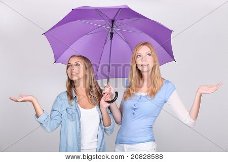 girls with purple umbrella