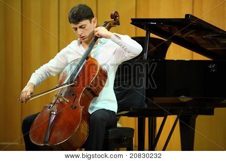 MOSCOW - JANUARY 14: Narek Hakhnazaryan plays Antonio Stradivari cello in organ hall of Museum of Musical of Culture named Glinka on January 14, 2011 in Moscow, Russia.