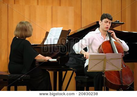 MOSCOW - JANUARY 14: Narek Hakhnazaryan plays Antonio Stradivari cello, Gayane Hakhnazaryan plays piano in organ hall of Museum of Musical of Culture named Glinka on January 14, 2011 in Moscow, Russia