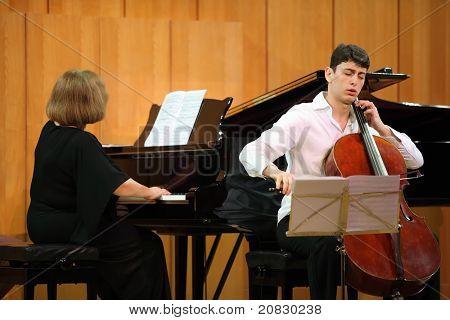 MOSCOW - JANUARY 14: Narek Hakhnazaryan plays Antonio Stradivari cello, Gayane Hakhnazaryan plays piano in organ hall of Museum of Musical of Culture named Glinka on January 14, 2011 in Moscow, Russia
