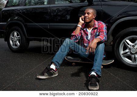 Skateboarding Guy Talking On The Phone