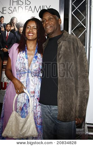 LOS ANGELES - APR 12: Danny Glover and wife at the World Premiere of 'Death At A Funeral' held at the Arclight Theater in Los Angeles, California on April 12, 2010.