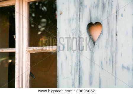 fretwork heart made on wooden shutter