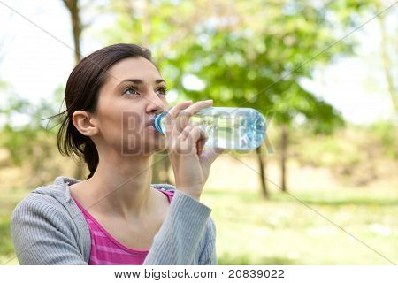 Girl Drinking Water In The Park