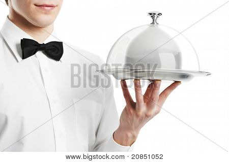 Close up waiter hand with tray and metal cloche lid cover