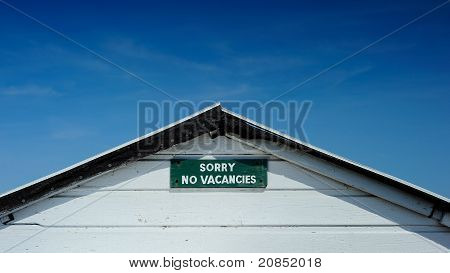No Vacancies Sign Set Against Deep Blue Sky