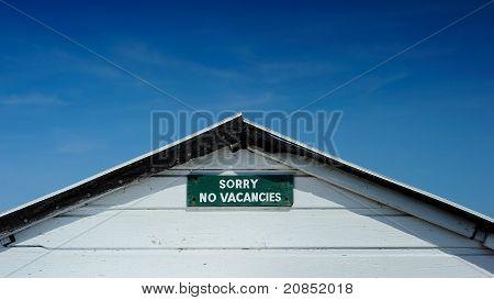 No Vacancies Sign Set Against Deep Blue Sky