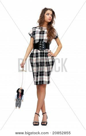 Woman Holding A Doll Puppet