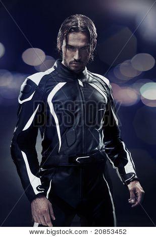 Stylish man wearing motorbike uniform
