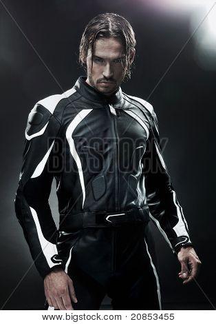 Handsome man wearing motorbike uniform
