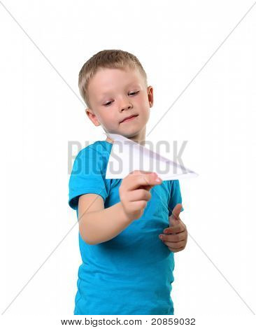 little boy in blue T-shirt with paper plane in studio