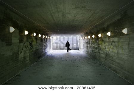 Man Passing Through Underpass