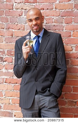 Young Business Man With A Glass Of Wine