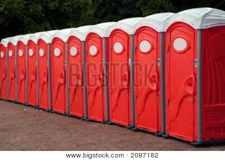 Row Of Red Portable Toilets