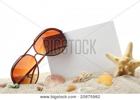 summer holidays memories card from beach with shells and sunglasses on sand
