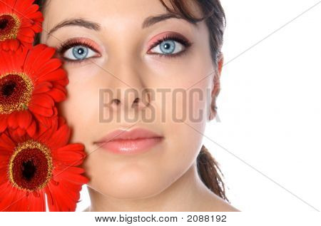 Young Woman With Red Gerberas