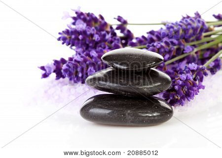 Stacked Black Stepping Stones And Lavender Flowers