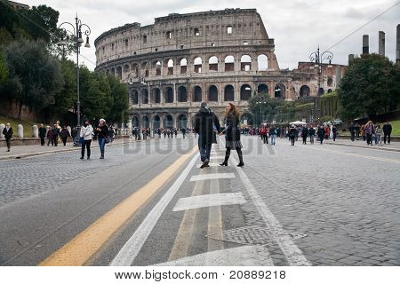 Tourists Walk To Colosseum In Rome