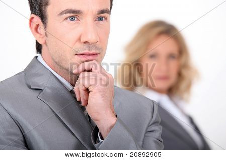Businessman resting his hand on his chin