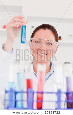 Young Scientist Looking At Test Tubes With The Camera Focus On The Scientist