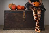 Happy Halloween! Female Feet In Stockings With An Orange Pumpkin. poster