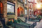 Chicago row house neighborhood at sunset poster