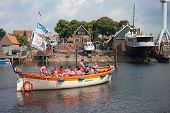 Urk, The Netherlands - Jun 11: A Tourist Vessel With The Members Of A Traditional Sailors  Choir Sin
